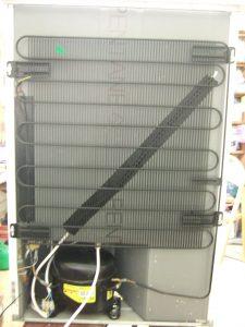 Back of fridge, showing component parts